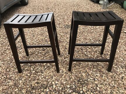 2 wooden brown stools.