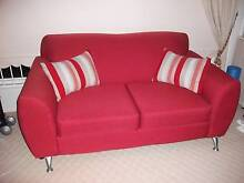 Red two seater Sofa and two cushions Kurrajong Hawkesbury Area Preview