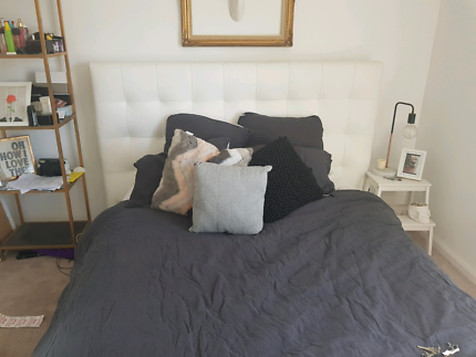 White leather look queen bed