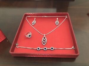 Brand new set of silver sapphire complete set