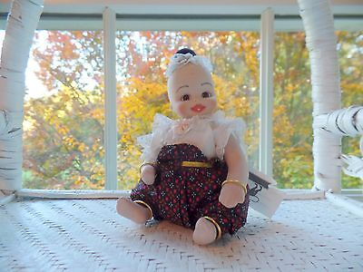 "Thai Toddler Doll with Two Teeth is All-porcelain and 5"" Tall Seated  (New)"