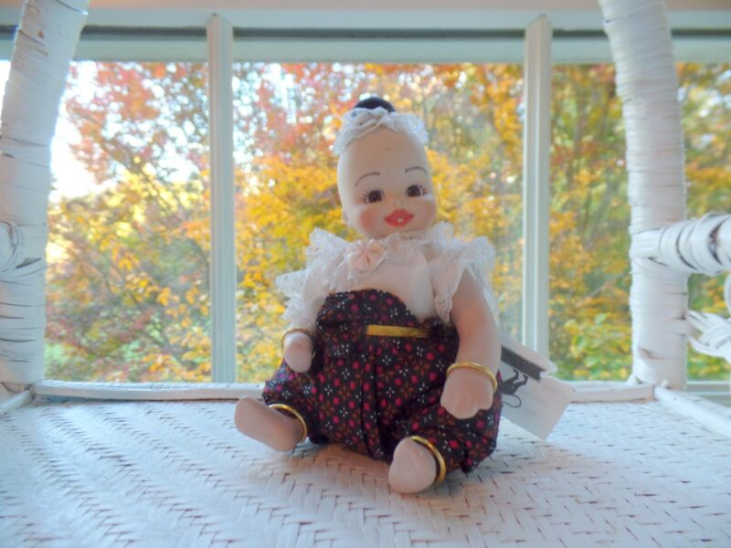 """Thai Toddler Doll with Two Teeth is All-porcelain and 5"""" Tall Seated  (New)"""