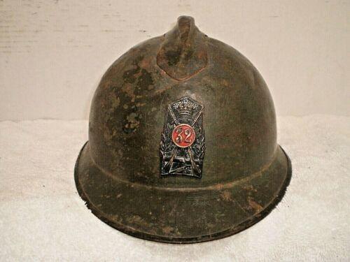 WW1 Italian adrian steel helmet with badge