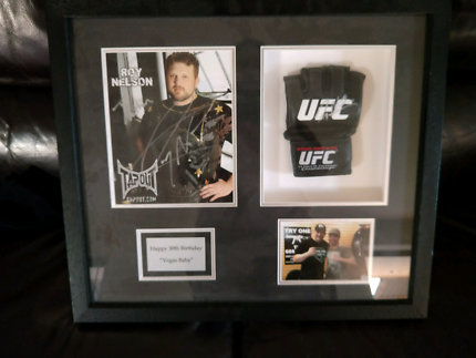 Signed and framed Roy Nelson UFC glove