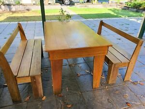 Outdoor solid wood table and benches