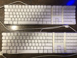 TWO APPLE KEYBOARDS WIRED