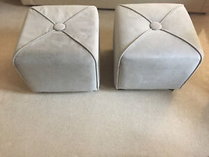 Two grey ottomans