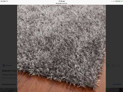 Giant Grey Shaggy $75 Awesome neutral tones will match with anything!