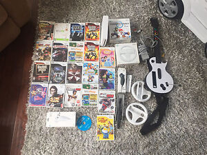 Wii with 22 games! Must sell