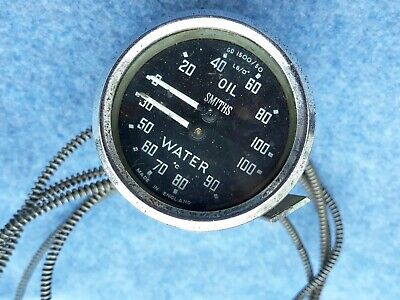 SMITHS DUAL TEMP AND OIL PRESSURE GAUGE marked in Centigrade.