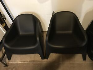 2 black comfy chairs.
