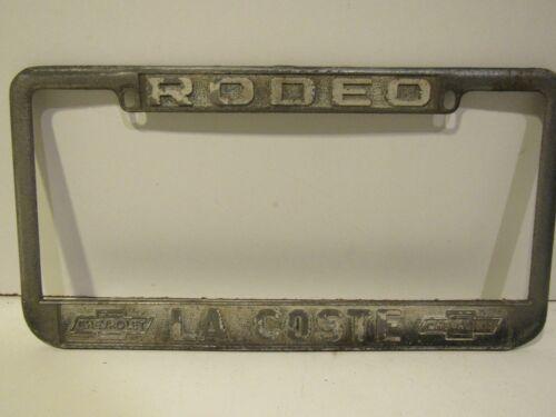 Rare Rodeo CA La Coste Chevrolet Embossed Dealership License Plate Frame Old