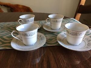 Four tea cups and saucers