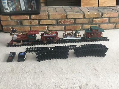 Christmas train set Remote Control. ( Not Working) Fixable W Light Up Cars.