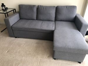 Moving sale- Sectional sofa bed with storage