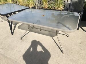 Patio table with six chairs. And umbrella & base-stand
