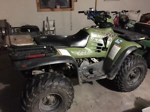 99 Polaris Sportsman 500 with plow.