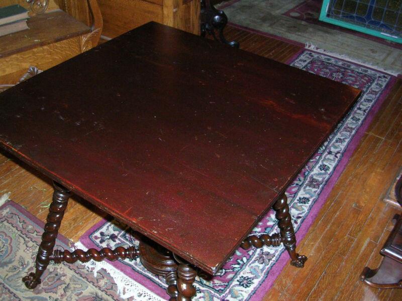 antique mahogany hunzinger merklen center table stick and ball claw & ball feet