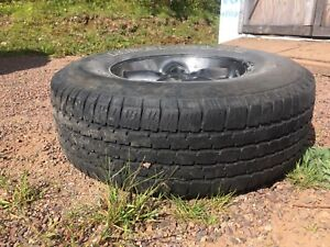 Tires with rims for a jeep tj