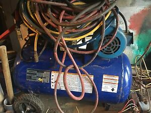Air compressor with hoses