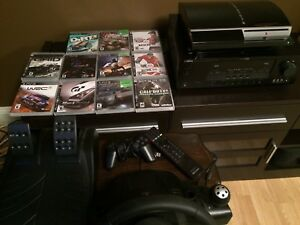 For Sale PS3 with Logitech wheel and pedals 11 games