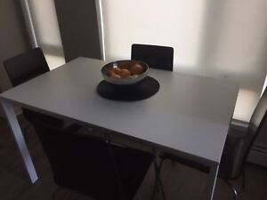 IKEA White dinning table w/ black chairs