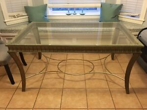 Glass table and metal framed chairs