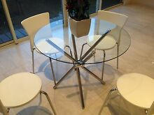 Round glass design dining table, 4 white chairs inclusive Brighton Bayside Area Preview
