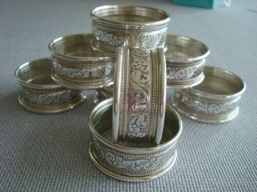 ALVIN sterling silver ~ SET OF 8 NAPKIN RINGS ~ EMBOSSED CLASSIC & FABULOUS!