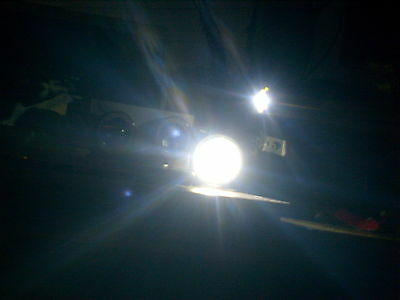 The original cornering lamp's fitted with an LED and on the left are projectors as fitted to my car, parking lamp above.