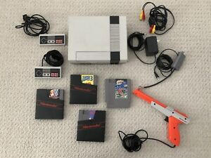 NES console pack with games, controllers, zapper gun