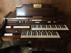 Gently used Gulbranson Paragon Organ and bench, sheet music