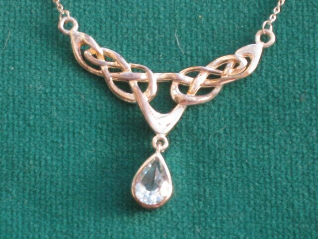 Ornate silver Art Nouveau style necklace with aqua marine drop