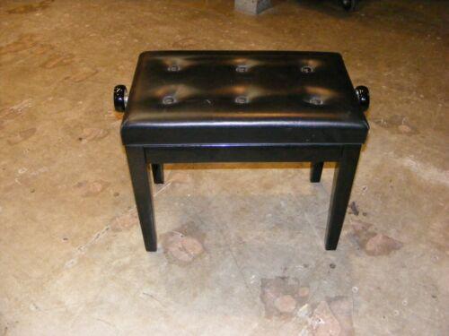 Adjustable polished ebony piano bench