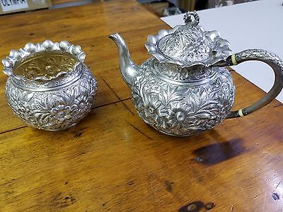 Antique repousse sterling silver teapot and sugar bowl