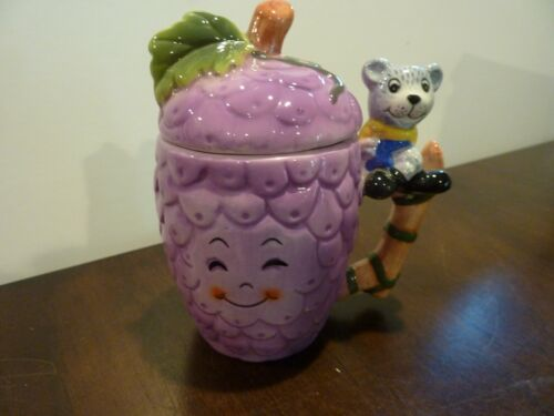 Purple grapes ceramic anthropomorphic handled covered jar / bear