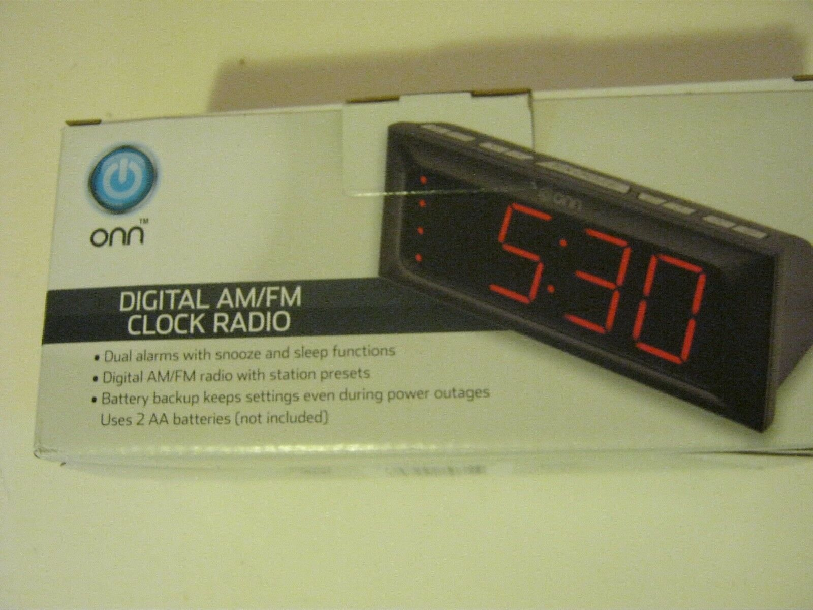 Digital am fm alarm clock onn