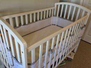 Wooden baby crib with accessories