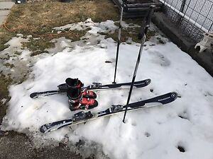 Skis boots and poles