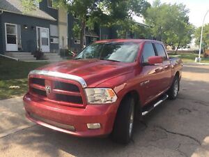 2009 Dodge Ram 1500 4 Dr w extra rim set and winters
