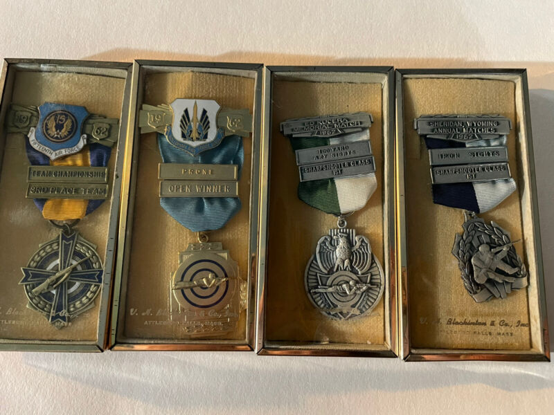 LOT OF 4-1962 SHARPSHOOTER MEDALS