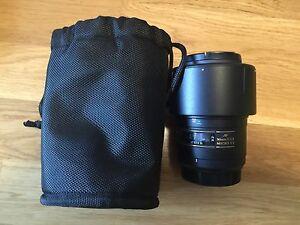 Nikon lens, film rolls