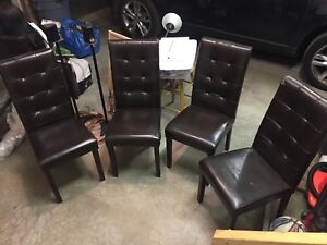 4 matching leather dining chairs