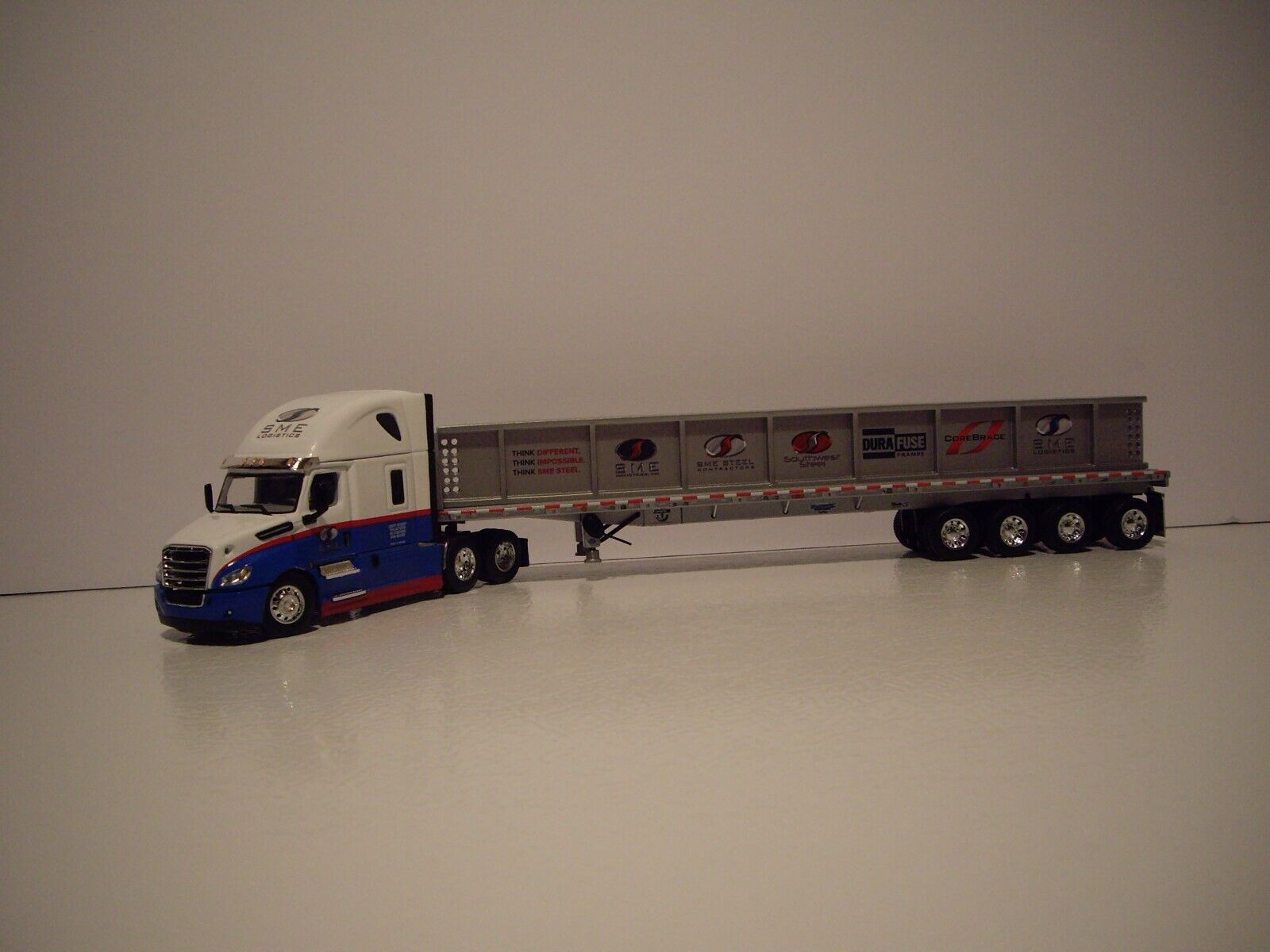 DCP 1/64 SME LOGISTICS FREIGHTLINER CASCADIA W/T SLEEPER & QUAD AXLE WITH LOAD