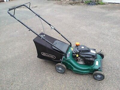 GARDEN petrol lawnmower in good working order.CLEAN CONDITION.