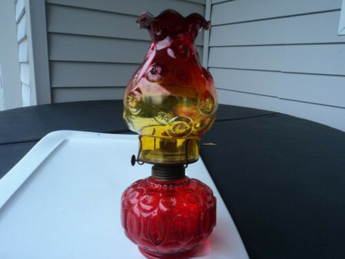U.S. GLASS SMITH MOON AND STAR AMBERINA RED OIL LAMP