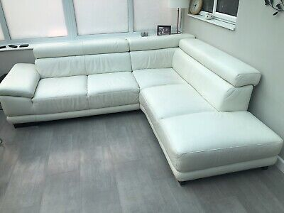 White leather corner sofa with adjustable headrests and armrest.