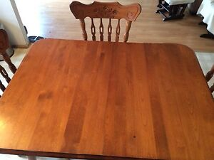 Hardwood dining room table and 4 chairs to match