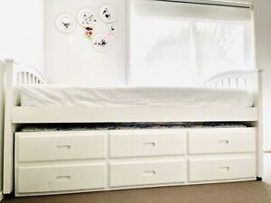 White timber solid pull out bed frame