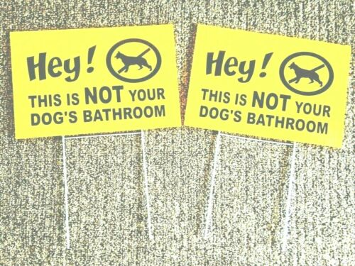 2 signs HEY! This is Not Your Dog